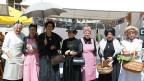 Eine Gruppe von Frauen in historischen Kostümen.