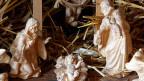 Maria, Josef und das Jesuskind in der Krippe.