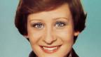 Junge Frau mit gewinnendem Lächeln.