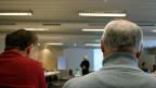 Zwei Männer während eines Referats.