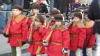 Eine Gruppe Buben in Wilhelm Tell-Kostümen.