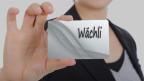 Schreibtafel auf dem das Wort Wächli steht.