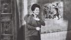 Die Schauspielerin Margrit Rainer in einer Filmszene.