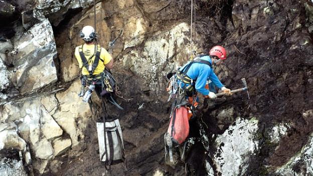 Arbeiter an der Felsbaustelle Lopper.