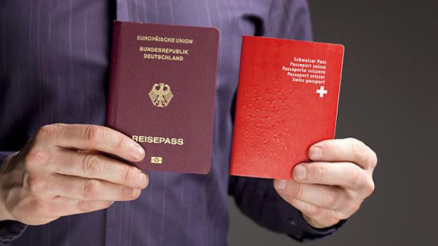 Deutscher und Schweizer Reisepass.