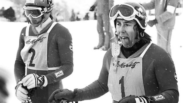 Bernhard Russi (Nr.2) und Roland Collombin (Nr.1) bei der Herren-Abfahrt während der alpinen Ski-Weltmeisterschaft in St. Moritz, Februar 1974.