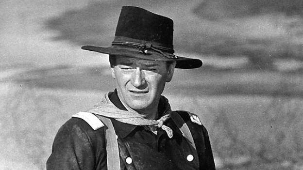 US-Schauspieler John Wayne waehrend der Drejarbeiten zu dem Film «The Horse Soldiers».