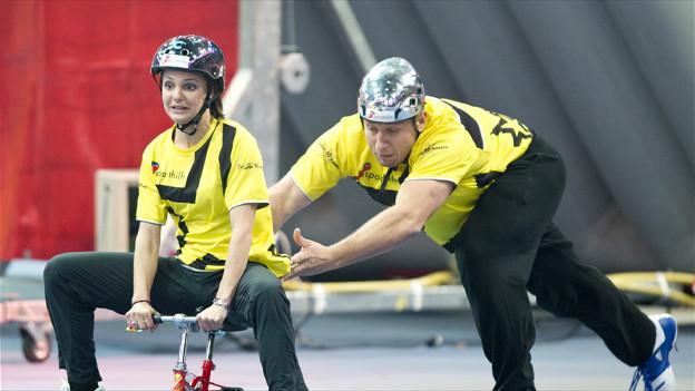 Die ehemalige Eiskunstläuferin Sarah Meier und der ehemalige Schwinger Joerg Abderhalden während dem Super10Kampf 2011.