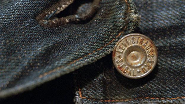 Jeans, einst Hosen für Rinderzüchter, sind bis heute das meistverkaufte Kleidungsstück und zutiefst amerikanisch.