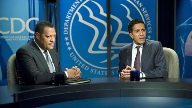 Laurence Fishburne (links), der Jurypräsident des diesjährigen Zurich Film Festival, als Dr. Ellis Cheever bei einem Fernsehinterview.