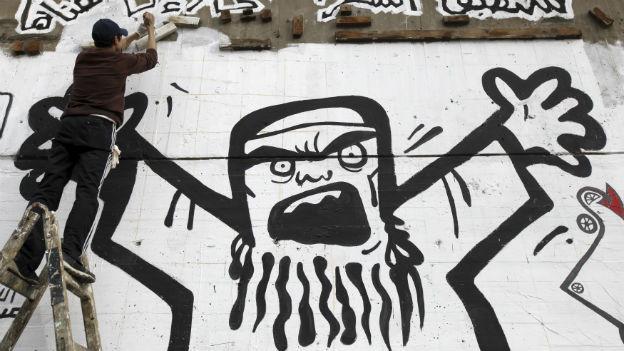 Ein Sprayer in Kairo nimmt die Muslimbruderschaft aufs Korn.