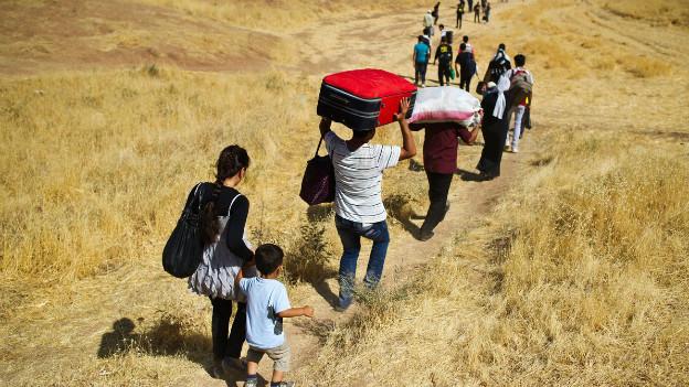 Syrische Kurden auf der Flucht vor dem Krieg.