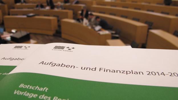 Der Aargauer Grosse Rat hat das Budget 2014 gutgehiessen. Der Steuerfuss des Kantons bleibt bei 94 Prozent.