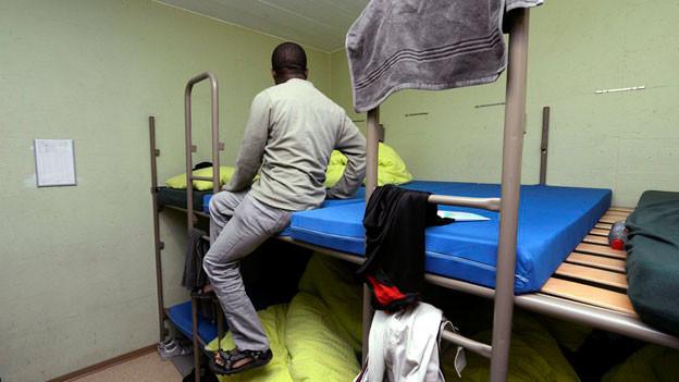 Asylbewerber in einem Bunker