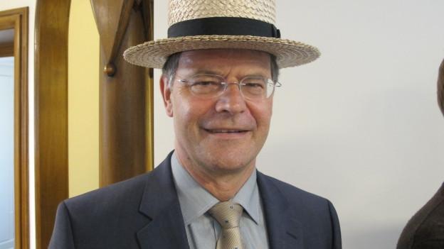 Porträtbild von Walter Dubler mit Hut.
