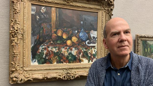 Langmatt-Direktor Markus Stegmann mit einem Bild von Cézanne