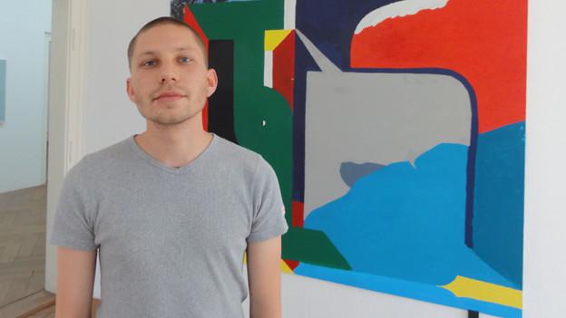 Levent Pinarci steht vor seinem Abschlusswerk.