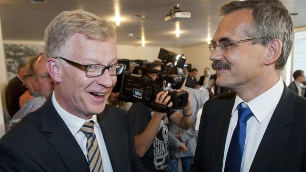 Jean-Pierre Siggen und Jean-François Steiert nach dem ersten Wahltag Mitte September.