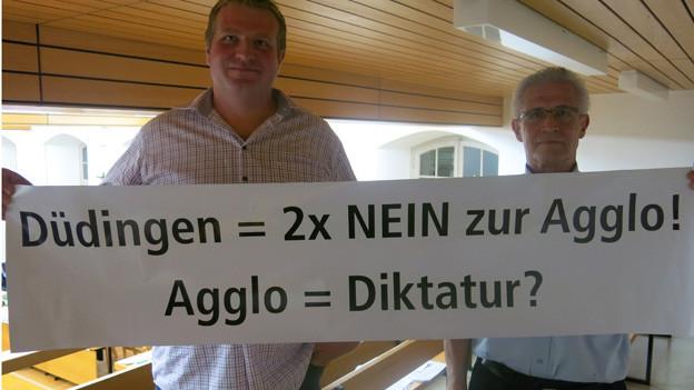 Protest nützt nichts - Düdingen muss in der Agglo Freiburg bleiben