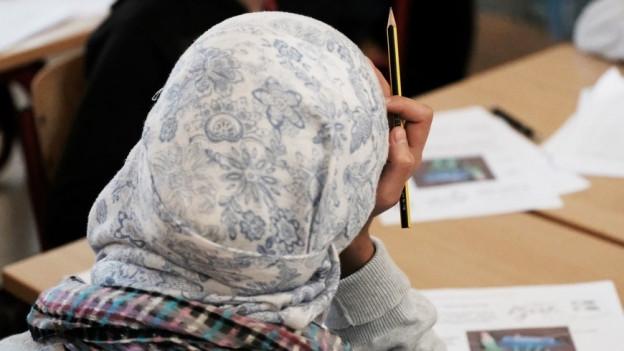 Die Initiative verlangte das Verbot von Kopfbedeckungen an Walliser Schulen.
