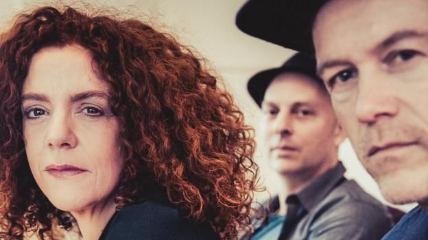 Shirley Grimes mit Wolfgang Zwieauer und Tom Etter (von links).