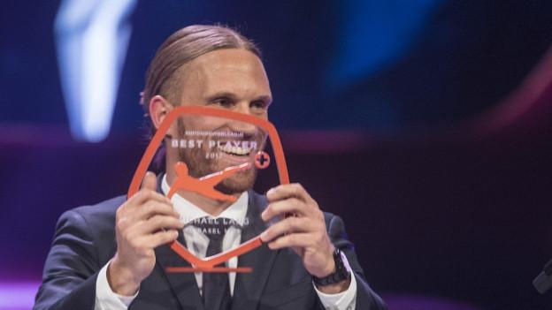 Michael Lang freut sich über die Auszeichnung