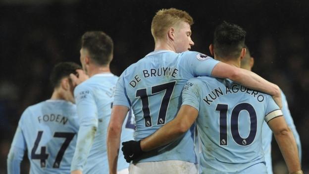 Jubelnde Manchester Spieler