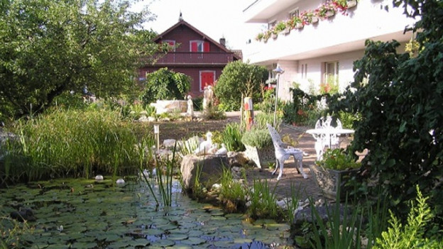Blick in den Garten der Werkstube Aesch