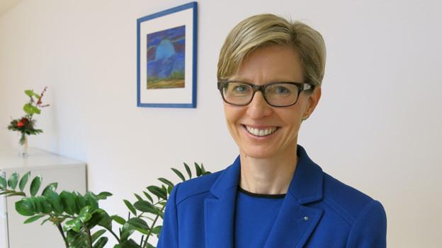 Porträtaufnahme von Ombudsfrau Lucia Schnider.