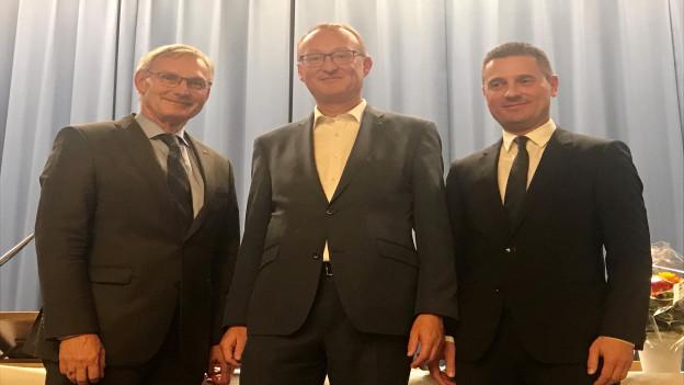 Drei Männer in Anzug,