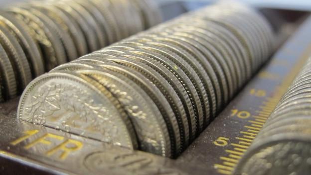 Einfränkler in einer Geldkassette