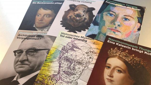 Sechs Ausstellungsplakate mit je einem Kopf