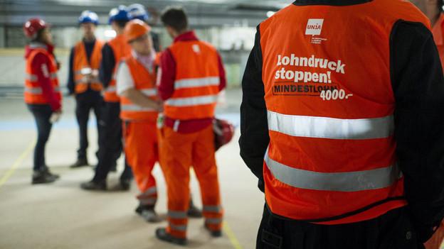 Bauarbeiter verweigern die Arbeit - Der Einsatz der Unia hat sich gelohnt.
