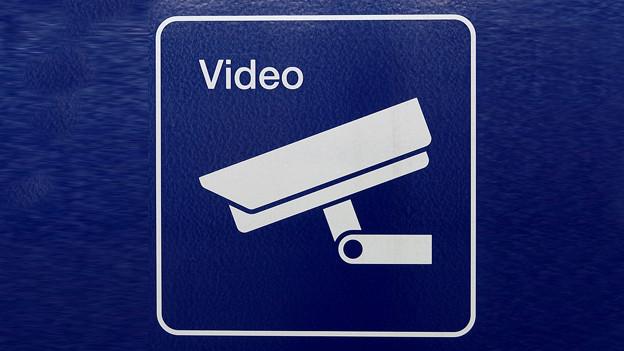 Ein Ikonogramm mit Videokamera und dem Schriftszug Video.