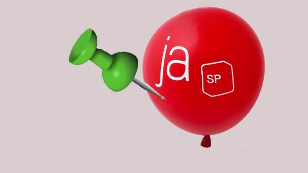 Eine grüne Nadel sticht in einen roten SP-Ballon.