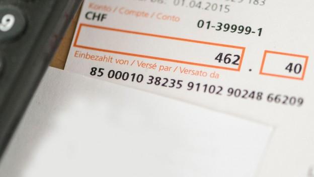Ein oranger Einzahlungsschein
