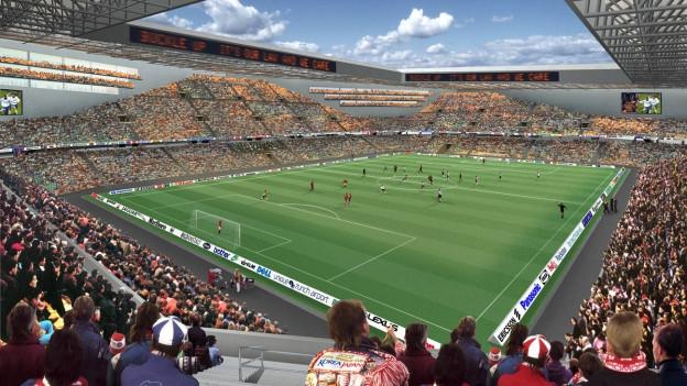 Die Zuschauern wohnen auf einer Simulation einem Fussballmatch im neuen Hardturmstadion bei.