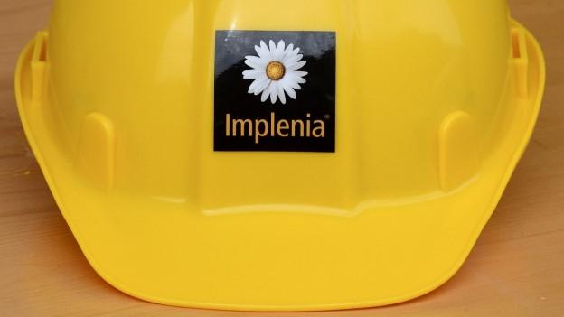Helm mit Logo des Baukonzerns Implenia