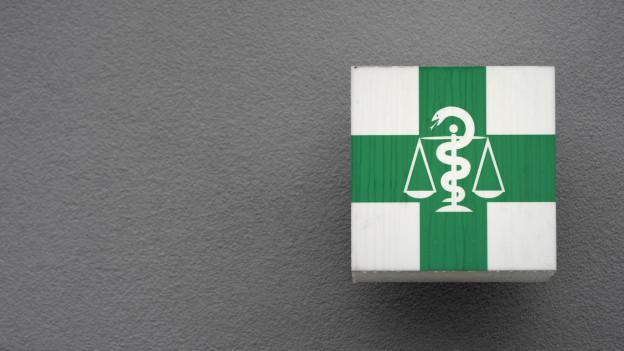 Der Äskulapstab, das Symbol des ärztlichen und pharmazeutischen Standes.