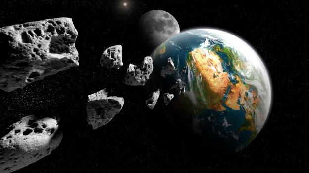 Illustraziun dad asteroids e la terra.