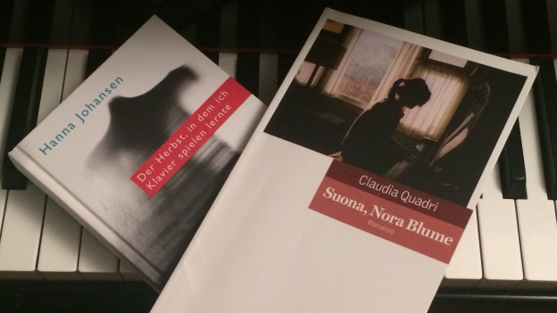 Ils dus romans da Hanna Johansen e Claudia Quadri sin il clavazzin.