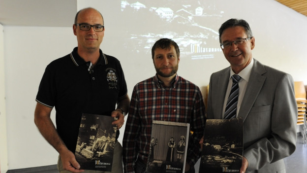 Armin Spescha (communicaziun e marketing), David Flepp (manader artistic) e Rino Caduff (president dal comité d'organisaziun).