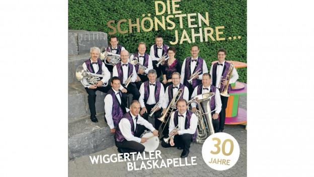 Fotografia da gruppa da la «Wiggertaler Blaskapelle» per la cuverta dal DC