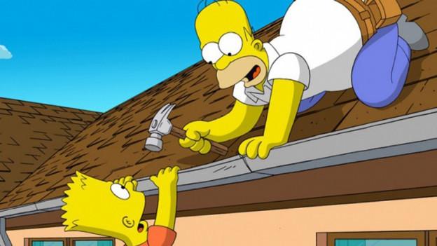 Homer Simpson cun fegl Bart.
