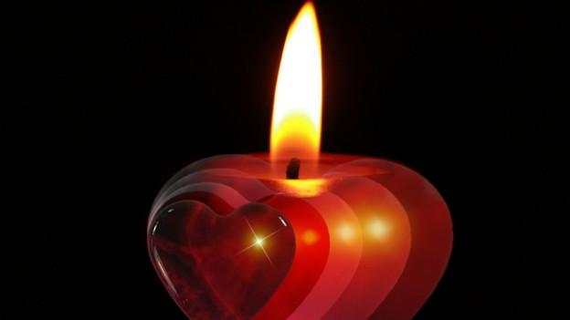 Ina candeila en fuorma da cor