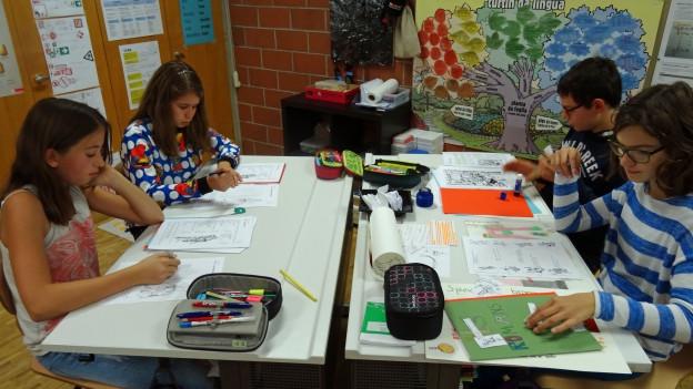 Scolars e scolaras da la 5avla primara Savognin