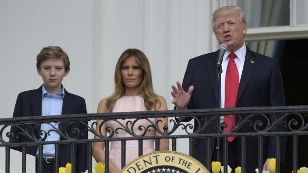 Barron, Melania e Donald Trump.