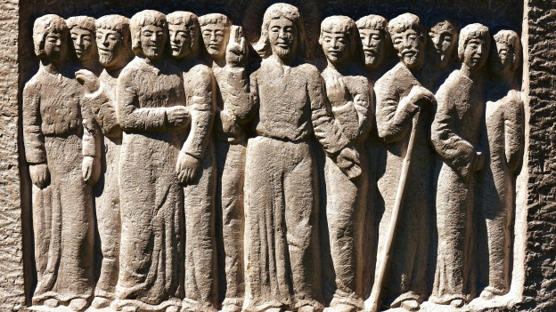 Jesus cun ils 12 apostels.