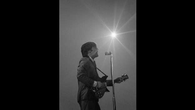 John Lennon durant in concert cun ils Beatles