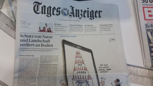 Il Tages Anzeiger po envidar oz 125 chandailas.